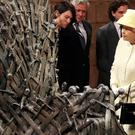Queen Elizabeth meets cast members of the HBO TV series 'Game of Thrones' Lena Headey and Conleth Hill as she views some of the props including the Iron Throne on the set of Game of Thrones in Belfast's Titanic Quarter (Photo by Jonathan Porter - WPA Pool/Getty Images)