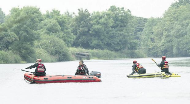 Emergency services search for the vehicle that plunged into the Newry Canal yesterday