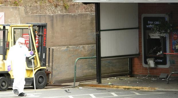 The scene in Keady after thieves used a bomb to steal cash from a cash machine. Pic Philip Fitzpatrick/Pacemaker