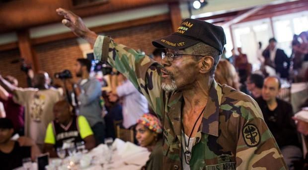 Harry Brooks dances during a lunch and press conference held by Chen Guangbiao, a Chinese recycling magnate, who hosted the event for homeless people, at the Boat House in Central Park, on June 25, 2014 in New York City. (Photo by Andrew Burton/Getty Images)