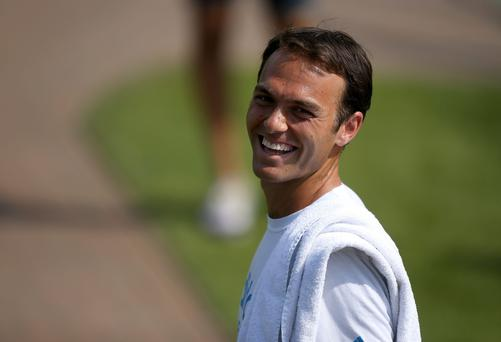 Ross Hutchins on day one of the Wimbledon Championships at the All England Lawn Tennis and Croquet Club, Wimbledon. PRESS ASSOCIATION Photo. Picture date: Monday June 23, 2014. See PA story TENNIS Wimbledon. Photo credit should read: John Walton/PA Wire. RESTRICTIONS: Editorial use only. No video emulation. No false commercial association. No manipulation of images. No use with any unofficial third party logos. No transmission of images to mobile services.