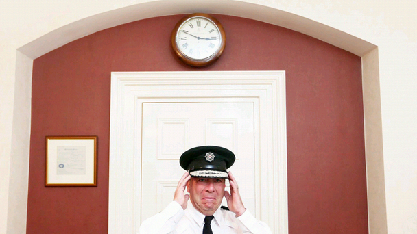 Outgoing PSNI Chief Constable Matt Baggott jokes around for the camera in his office at PSNI headquarters. After being asked to straighten his cap and look serious for the next photograph, Mr Baggott asked 'How am I supposed to stop smiling?' He then pulled a face and said 'Is this grumpy enough?'