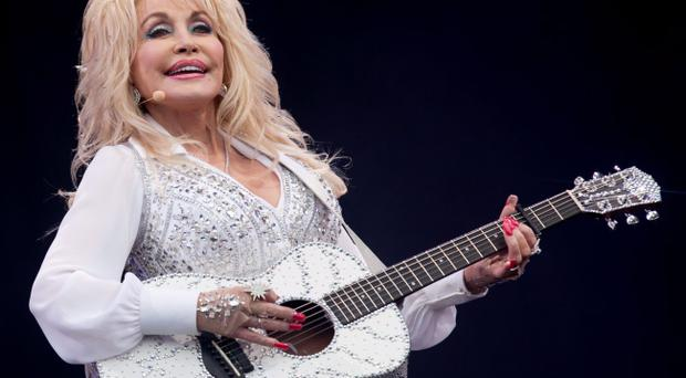Dolly Parton performing on the Pyramid Stage at the Glastonbury Festival