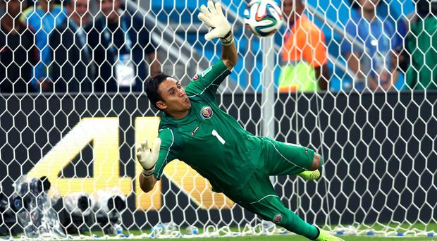 Keylor Navas of Costa Rica saves a penalty kick by Theofanis Gekas of Greece