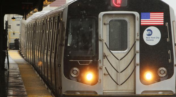 The incident happened at around 6am in front of horrified commuters at Times Square Station