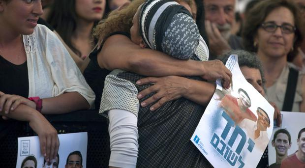 An Israeli woman hugs Iris Yifrah, mother of kidnapped Israeli teenager Eyal Yifrah on June 29. Pic Lior Mizrahi