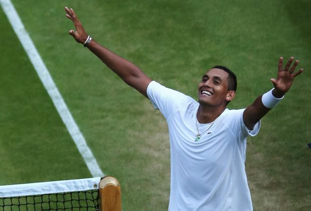 Nick Kyrgios of Australia celebrates match point against Rafael Nadal of Spain