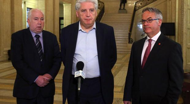 The SDLP negotiating team (left to right) Joe Byrne, SDLP leader Alasdair McDonnell and Alex Attwood, speak to the media ahead of a three-day session of intensive negotiations focused on long-standing disputes over flags, parades and the legacy of the past at Parliament Buildings, Stormont, Belfast.