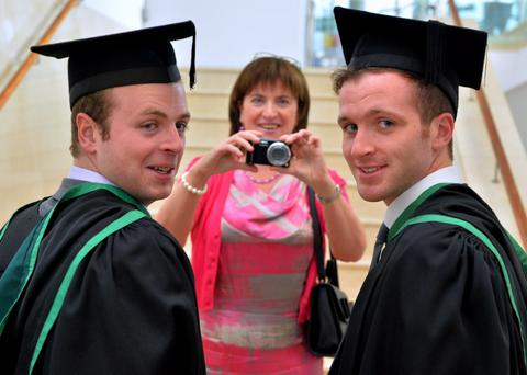 Mum Sinead Smyth captures the moment for her son Joseph Smyth who graduated in Sports Theory and Practice and fellow Dunloy student Padraig Elliot graduate in Diagnostic Radiography pictured at the University of Ulster summer graduations at the Waterfront Hall, Belfast. Photo by Aaron McCracken/Harrisons
