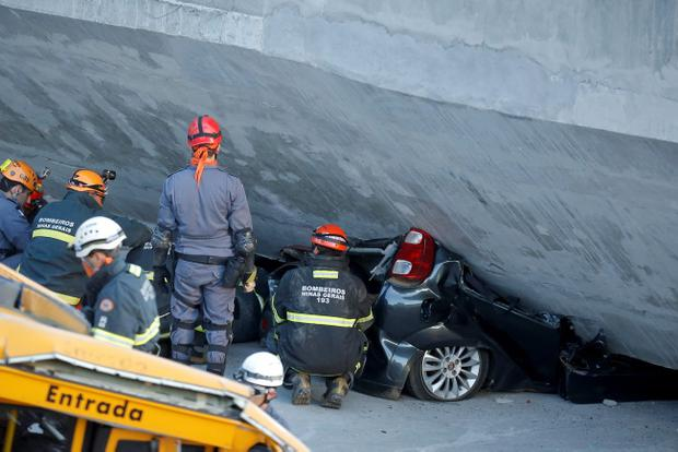 A car crushed by the flyover bridge after it collapsed