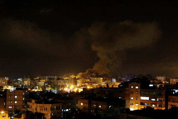 Smoke rises after an Israeli missile strike hit Gaza City, Thursday, July 3, 2014. (AP Photo/Hatem Moussa)