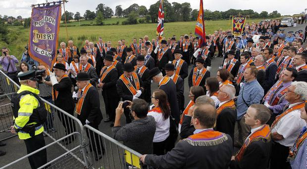 Members of the Orange order at Police Barriers at Drumcree Church as they take part in the annual Drumcree parade in Portadown on Sunday. PhotoAidan O'Reilly/Pacemaker Press