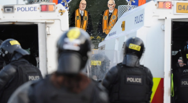 PSNI officers stand firm as trouble flared in the Ardoyne area on the Twelfth of July in 2013. Pic Charles McQuillan/Pacemaker