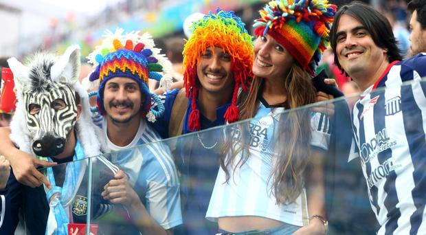 Argentina fans enjoy the atmosphere during the 2014 FIFA World Cup Brazil Semi Final match against Holland