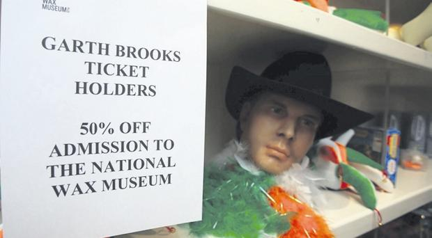 A sign beside a head of Garth Brooks at the Wax Museum, Dublin