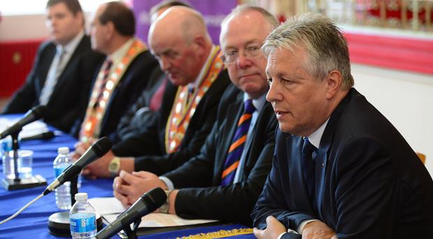 First Minister Peter Robinson and other unionist leaders alongside senior Orange Order figures at Thursday's press conference. Pic Arthur Allison