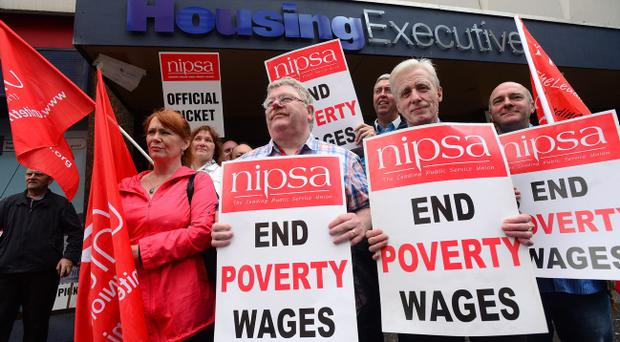 Council workers in Northern Ireland are joining public sector employees in England and Wales in strike action on Thursday. Union members pictured at the picket lines at a Housing Executive office in Belfast city centre. Photograph by Arthur Allison/Pacemaker