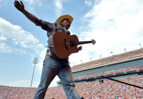 Garth Brooks performs during the Oklahoma Twister Relief Concert in Oklahoma (Photo by Rick Diamond/Getty Images for Shock Ink)