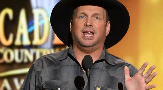 Garth Brooks speaks onstage during the 49th Annual Academy of Country Music Awards in Las Vegas, Nevada. (Photo by Ethan Miller/Getty Images)