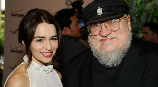 Game of Thrones actress Emilia Clarke and writer George R.R. Martin (Photo by Frazer Harrison/Getty Images For AFI)
