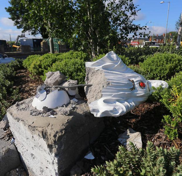 A statue of Mary lies damaged on the Falls Road - it's understood it was attacked on Friday morning. Pic Kevin Scott