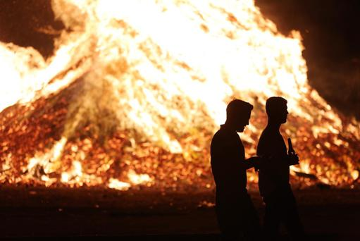 General view of a bonfire in the Lower Shankill Estate, west Belfast this evening. Picture by Kelvin Boyes / Press Eye
