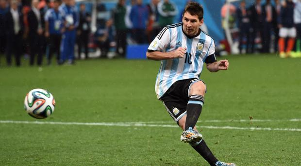 Lionel Messi of Argentina shoots and scores his penalty kick in a shootout during the 2014 FIFA World Cup Brazil Semi Final match between the Netherlands and Argentina at Arena de Sao Paulo on July 9, 2014 in Sao Paulo, Brazil. (Photo by Matthias Hangst/Getty Images)