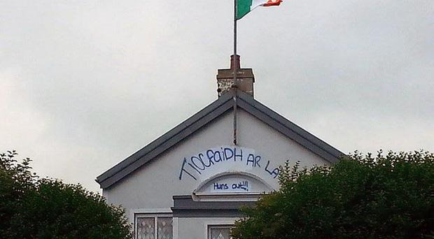 An Irish tricolour has been erected on an Orange Hall in Ballycastle and slogans were daubed on the building