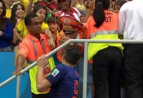 Holland's Robin van Persie gives his third place bronze medal to a Dutch fan after their victory over Brazil
