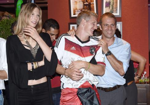 RIO DE JANEIRO, BRAZIL - JULY 13: Bastian Schweinsteiger of Germany, girlfriend Sarah Brandner and assistant coach Hansi Flick celebrate with teammates at a party, after winning the 2014 FIFA World Cup Brazil Final match against Argentina, at Sheraton Hotel on July 13, 2014 in Rio de Janeiro, Brazil. (Photo by Markus Gilliar - Pool/Getty Images)