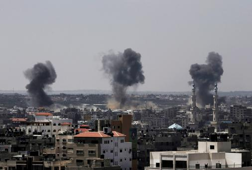 Smoke rises after Israeli missile strikes hit the northern Gaza Strip, Wednesday, July 16, 2014. (AP Photo/Adel Hana) - PEOPLE MAY FIND SOME OF THESE IMAGES DISTRESSING