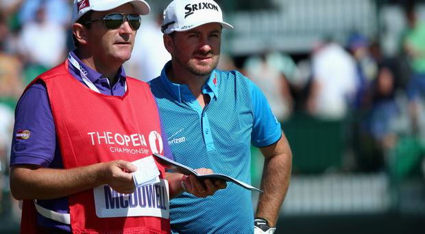 HOYLAKE, ENGLAND - JULY 17: Graeme McDowell of Northern Ireland chats with his caddie Ken Comboy on the fourth hole during the first round of The 143rd Open Championship at Royal Liverpool on July 17, 2014 in Hoylake, England. (Photo by Andrew Redington/Getty Images)