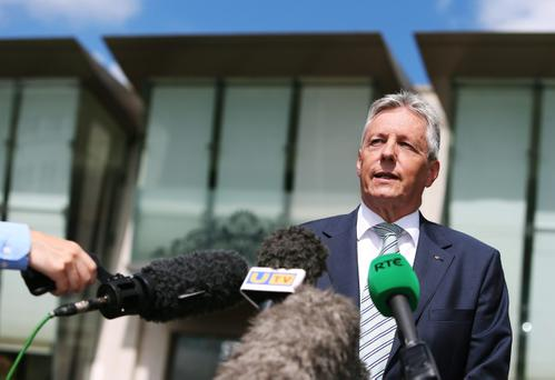 First Minister Peter Robinson speaks to the media outside the Stormont Hotel, Belfast, following the publishing of the Hallet Review into controversial amnesties for on the run prisoners