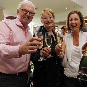 Terry Carr, Deirdre McGuigan and Julie Carr enjoy champagne at Holywood Golf Club after their very own Rory McIlroy's victory in the Open. Photo Aidan O'Reilly/Pacemaker Press