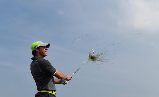 Rory McIlroy of Northern Ireland plays a shot from the rough on the fifth hole during the second round of The 143rd Open Championship at Royal Liverpool on July 18, 2014 in Hoylake, England. (Photo by Stuart Franklin/Getty Images)