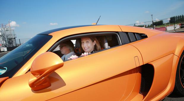 Reporter Rebecca Black in the supercar from the Belfast Motor Show