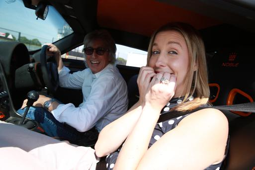 Reporter Rebecca Black in the supercar from the Belfast Motor Show with Peter Boutwood