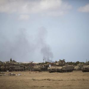 Israeli tanks seen near the Israeli-Gaza border on July 25, 2014 near Israel's border with the Gaza Strip. (Photo by Ilia Yefimovich/Getty Images)