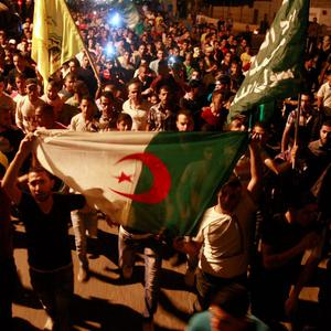 In this Friday, July 25, 2014 photo, Palestinians chant slogans to support the Palestinians in Gaza as others hold the Turkish flag, while protesting in the West Bank city of Jenin. (AP Photo/Mohammed Ballas)