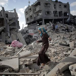 A Palestinian woman inspects the damage of her destroyed house during a 12-hour cease-fire in Gaza City's Shijaiyah neighborhood, Saturday, July 26, 2014 (AP Photo/Khalil Hamra)