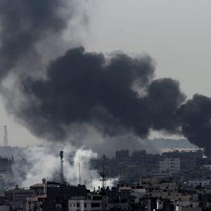 Smoke from Israeli strikes rises over Gaza City, in the northern Gaza Strip, Sunday, July 27, 2014. (AP Photo/Adel Hana)