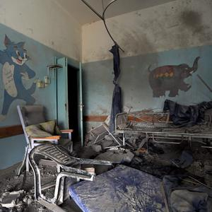 Damage from Israeli strikes leaves a room in the children's ward scattered with debris, at a hospital in Beit Hanoun, northern Gaza Strip, Sunday, July 27, 2014. (AP Photo/Lefteris Pitarakis)