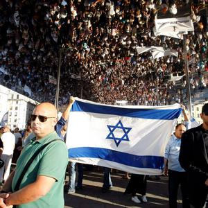Supporters of Israel are reflected in a mirror built on the Old Port during a demonstration in Marseille, southern France, Sunday, July 27, 2014 (AP Photo/Claude Paris)