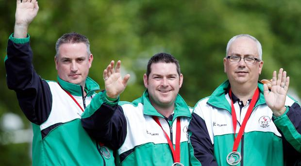 Northern Ireland's Paul Daly, Neil Mulholland and Neil Booth take silver in the Men's Triples Final at Kelvingrove Lawn Bowls Centre. Pic Danny Lawson