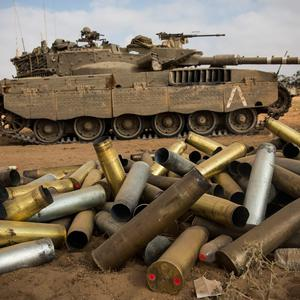 Used artillery shells litter the ground on the morning of July 28, 2014 near Kafar Azza, Israel. (Photo by Andrew Burton/Getty Images)