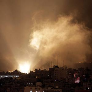 Smoke raises in the air following Israeli shelling in Gaza City on early Tuesday, July 29, 2014. (AP Photo/Khalil Hamra)