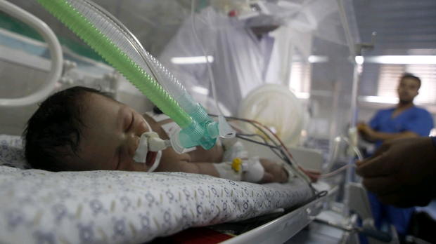 Palestinian baby girl Shaymaa Sheikh al-Eid lies in an incubator at Nasser Hospital, two days after surgeons delivered her after her mother died.