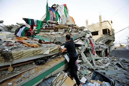 A Palestinian walks on the rubble of the house of the top Hamas leader in Gaza, Ismail Haniyeh, hit by a pre-dawn Israeli strike, in Gaza City, northern Gaza Strip, Tuesday, July 29, 2014 (AP Photo/Lefteris Pitarakis)