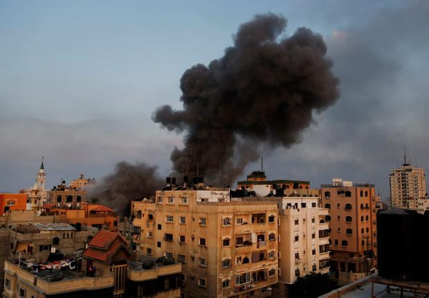 Smoke rises from the offices of the Hamas movement's Al-Aqsa satellite TV station, in Gaza City, northern Gaza Strip, shortly after was hit and destroyed by an Israeli strike, Tuesday, July 29, 2014. (AP Photo/Hatem Moussa)