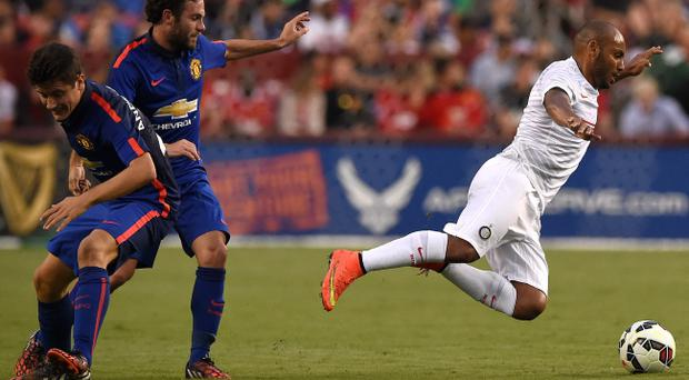 LANDOVER, MD - JULY 29: Jonathan #2 of Inter Milan is tripped up against Manchester United in the first half during their match in the International Champions Cup 2014 at FedExField on July 29, 2014 in Landover, Maryland. Manchester United won, 5-3, in a penalty shootout. (Photo by Patrick Smith/Getty Images)